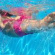 Underwater pink bikini little girl swimming in pool — Foto de Stock