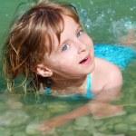 Blond girl swimming in lake river — Stock Photo