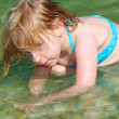 Blond girl swimming in lake river — Stock Photo
