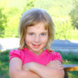 Blond little girl portratit happy smiling facing camera — Stock Photo #5514170