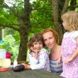 Mother daughter family picnic outdoor park - Stock Photo