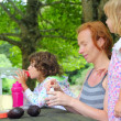 Mother daughter family picnic outdoor park — Stock Photo