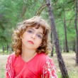 Pensive girl in forest nature tree thinking gesture — Foto de Stock