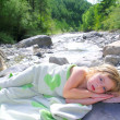 Royalty-Free Stock Photo: Girl towel in river lying relaxed after swimming
