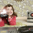 Camera retro photo little girl in vintage room - Stock Photo