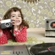 Royalty-Free Stock Photo: Camera retro photo little girl in vintage room
