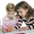 Two little sister student doing homework - Foto de Stock