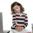 Drawing girl with marker on desk laptop — Stock Photo