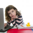 Books and laptop desk with student girl — Stock Photo #5514313