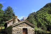 Stone mountain house in Pyrenees mountains — Stock Photo