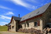 Mountain stone house slate roof in Pyrenees — Stock Photo