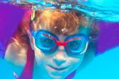 Underwater swimming girl goggles blue water — Stok fotoğraf