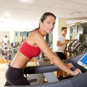Gym treadmill running young woman interior — Stock Photo