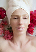 Spa flowers relaxing massage theraphy. Female thirty to fourty y — Stock Photo