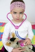 Little girl pretending to be doctor, stethoscope — Stok fotoğraf