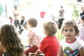 Spectator children looking at the show — Stock Photo