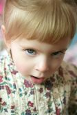 Beautiful toddler girl funny angry gesture — Stock Photo