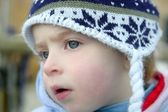 Little girl with wooden winter hat — Stock Photo