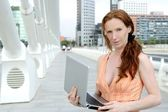 Beautiful redhead woman with laptop — Stock Photo