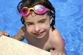 Beautiful little girl smiling in pool — Stock Photo
