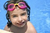 Beautiful little girl smiling in pool — Стоковое фото