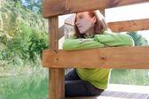 Redhead woman looking at river — Stock Photo