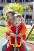 Little girls preschool playing park playground — Stock Photo