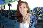 Happy woman tourist traveling bus indoor — Stock Photo
