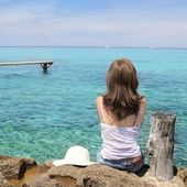 Tourist back woman looking Formentera turquoise sea — Stock Photo