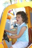 Little gird playing driving toy car — Stock Photo