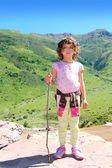 Explorer mountain girl hicker stick cane green valley — Stock Photo