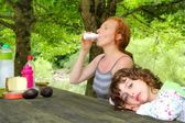 Mother daughter picnic outdoor park — Stock Photo