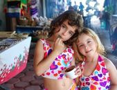 Sister little girls eating chocolate ice cream summer — Stock Photo