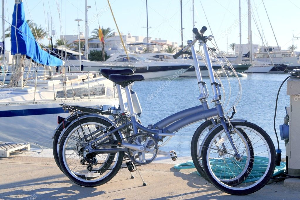 Two bicycles marine folding bike marina port Formentera Balearic islands — Stock Photo #5510546