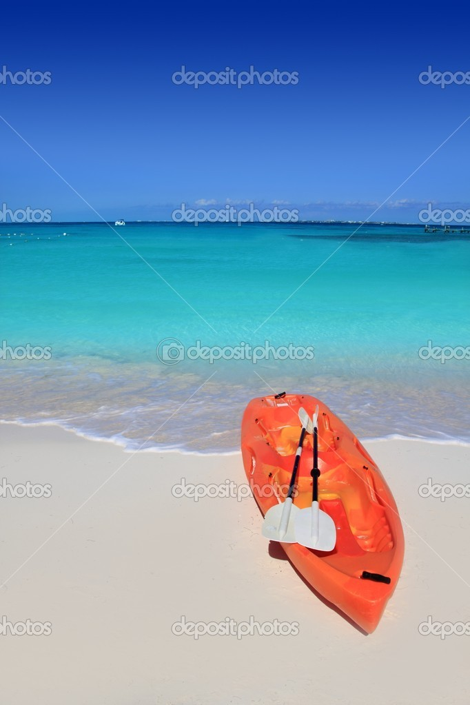 Kayak in beach sand caribbean sea turquoise water  Stock Photo #5511151