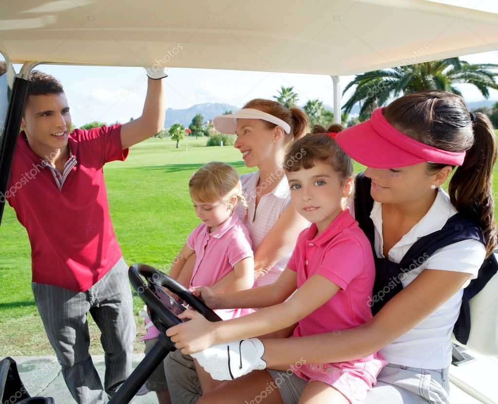 Golf course mothers and daughters in buggy talking father  Stock Photo #5511563