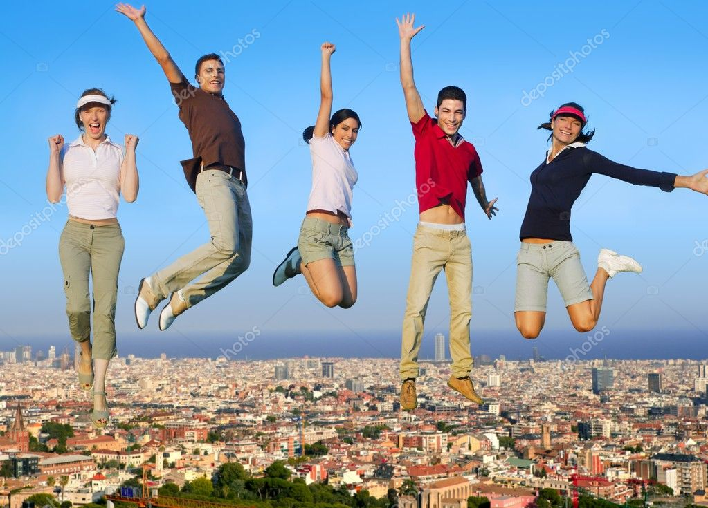 Jumping young happy group over city buildings cityscape — Stock Photo #5511671