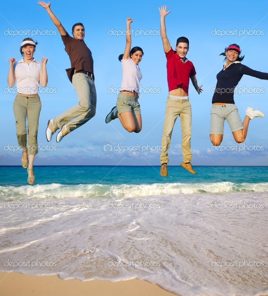 Jumping young happy group vacation tropical beach — Stock Photo #5511675