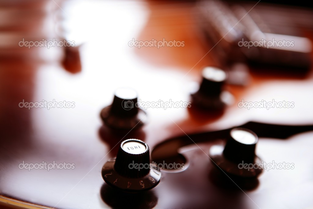 Jazz classic guitar macro detail, wooden box in orange — Foto de Stock   #5511715