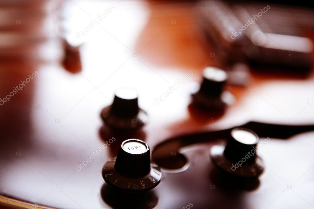 Jazz classic guitar macro detail, wooden box in orange — Stockfoto #5511715