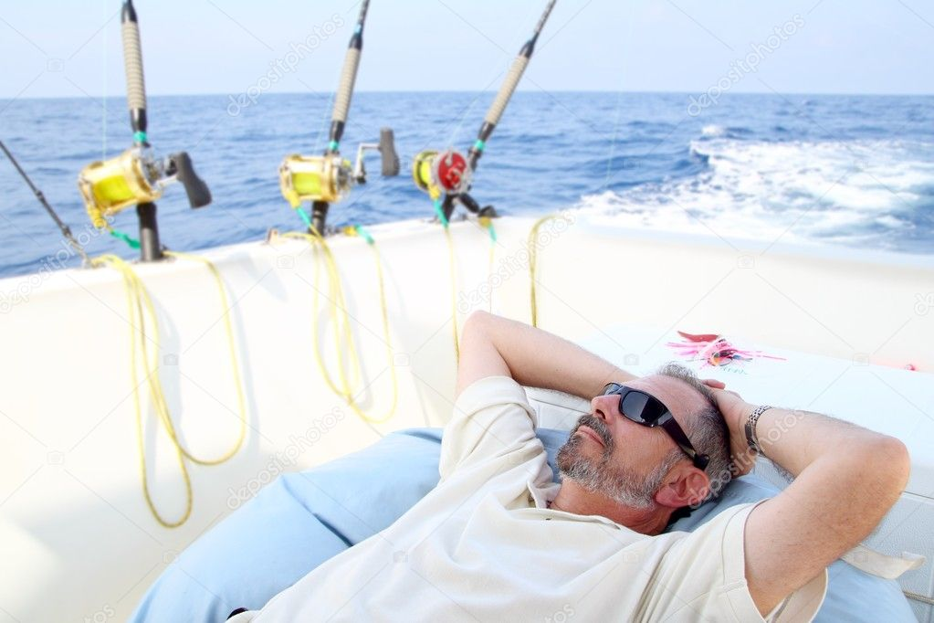 Sailor senior fisherman relax on boat fishing deep sea — Stock Photo #5511730