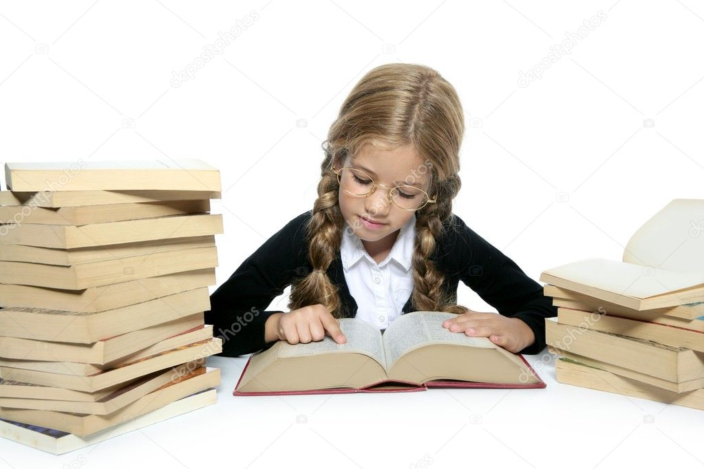 Little blond student school girl reading old book on white background — Stock Photo #5512532