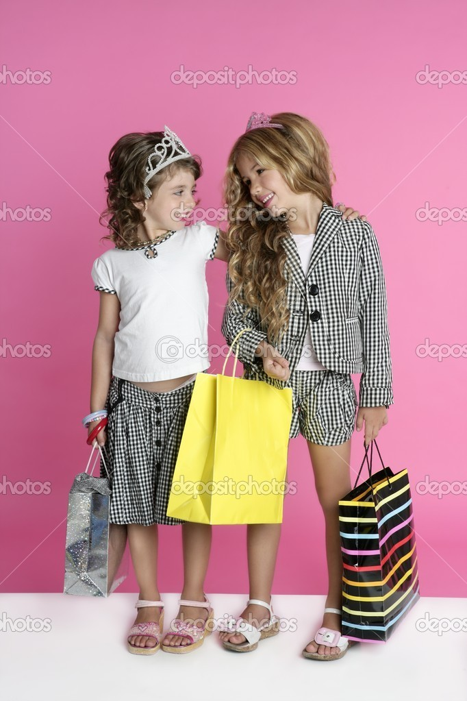 Little shopper humor shopaholic two girls stand full length pink background — Stock Photo #5512639