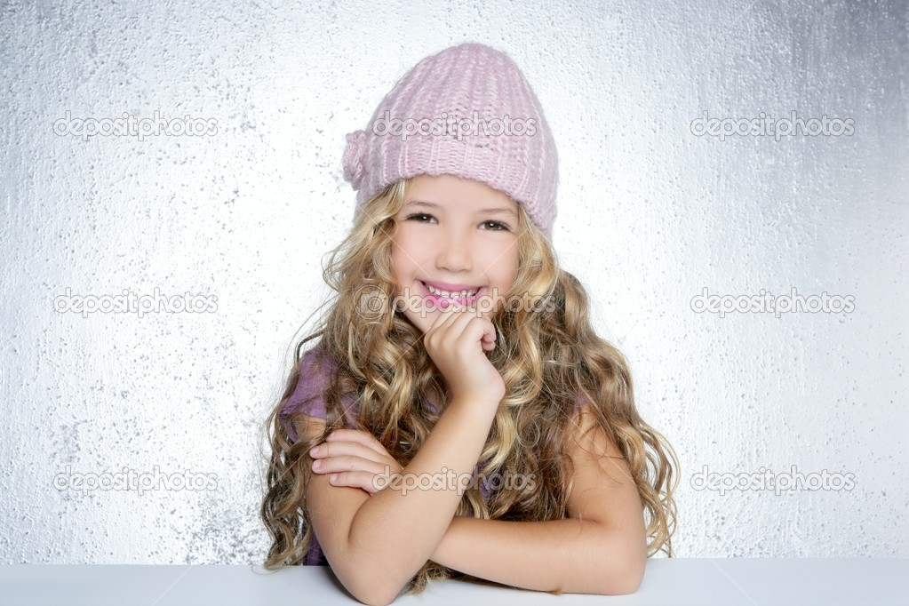 Smiling gesture little girl winter pink cap portrait silver background — Stock Photo #5512654