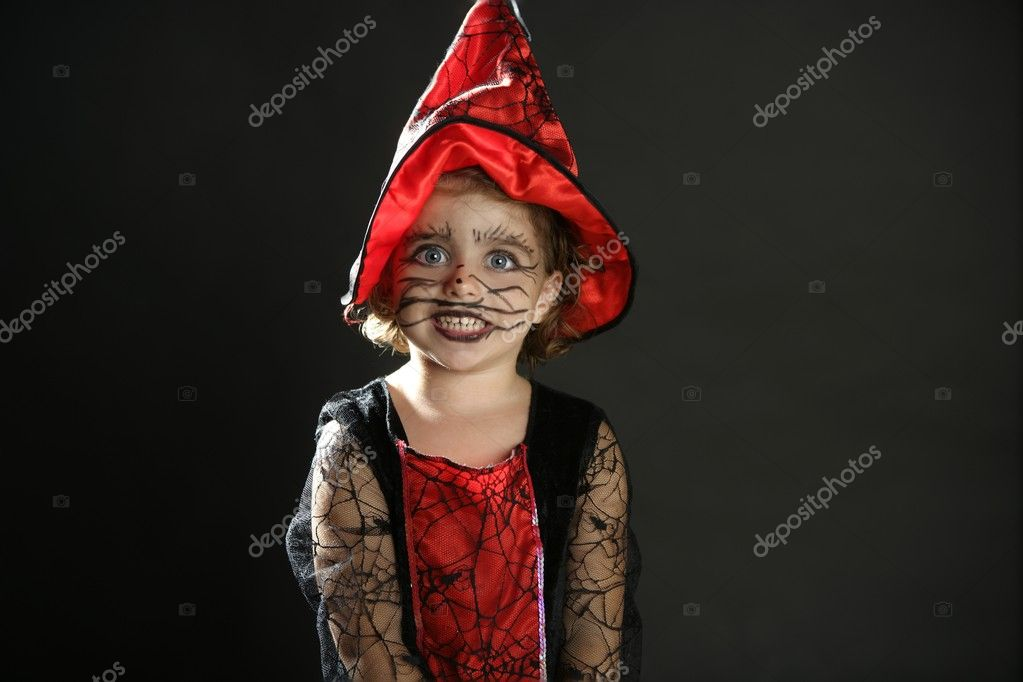 Toddler beautiful witch girl wearing halloween costume and make up — Stock Photo #5512789