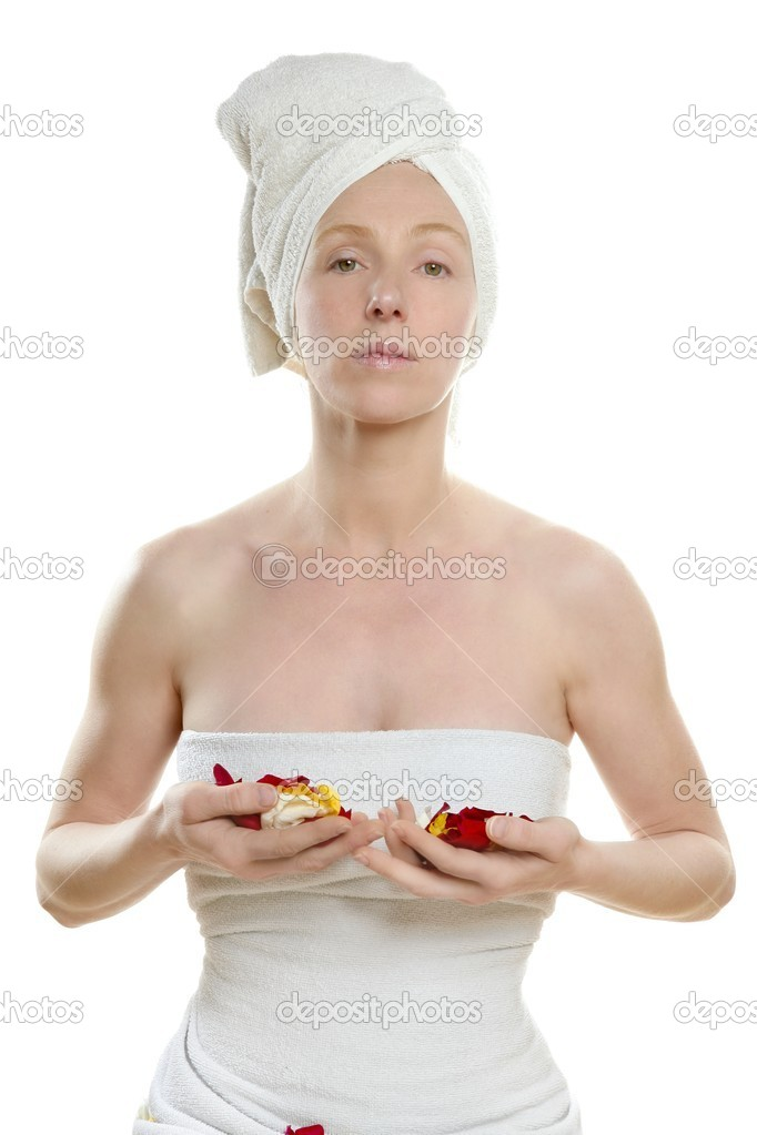 Woman on her knees holding rose colorful petals, bath spa towel  Stock Photo #5512804