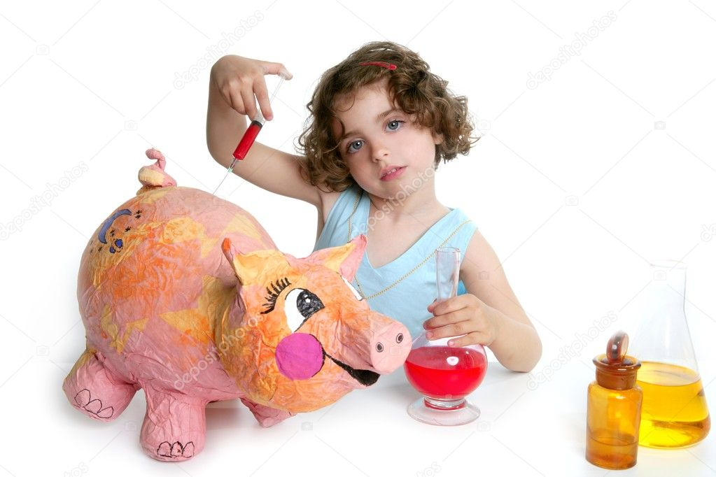 Little girl pretending to be a veterinary with a pig, AH1N1 flu  Stock Photo #5512806