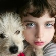 Dog puppy pet and girl hug portrait closeup blue eyes — Stock Photo #5553587