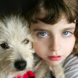 Dog puppy pet and girl hug portrait closeup blue eyes - Stock Photo