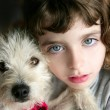Dog puppy pet and girl hug portrait closeup blue eyes — Stock Photo #5553693